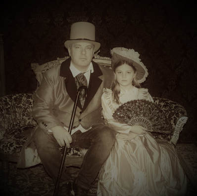 Father and daughter in Old Tyme parlor dress